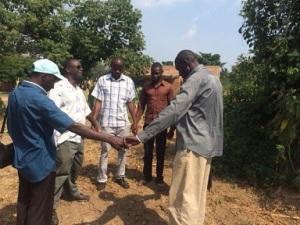 Praying_for_Kibale_church_sm