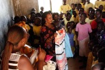 Esther with Naomi handing out clothes to women