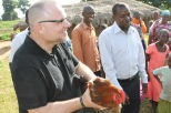 Pastor Brian receives chicken as gift from 3rd church Sunday